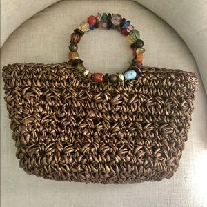 Cappelli Straworld brown bag with beaded handles.